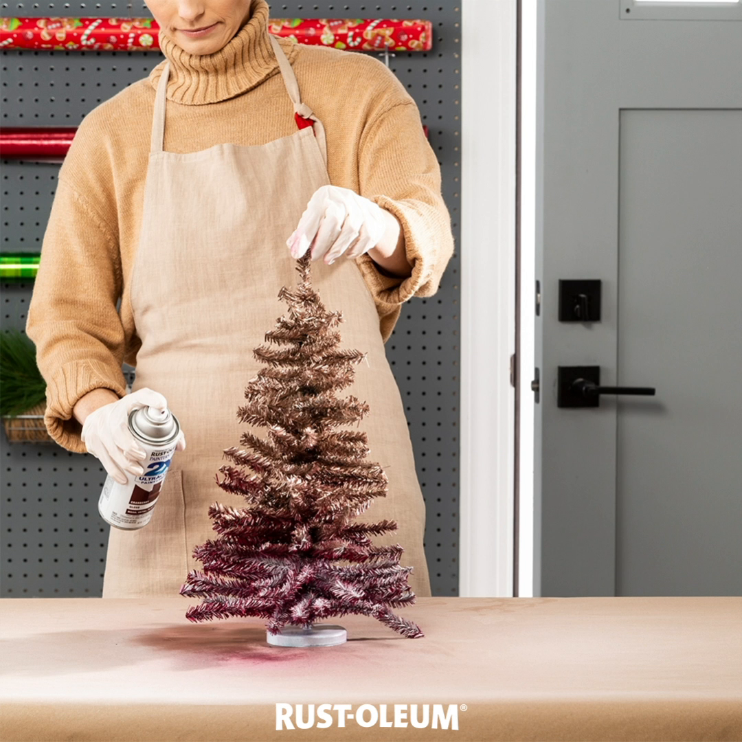 O Christmas Trees, O Christmas Trees, how ombré are thy branches. Turn your traditional trees into colorful Christmas centerpieces with Rust-Oleum Universal Bonding Primer and 2X Ultra Cover, Bright Coat Metallic and Universal Metallic Spray Paint. 'Tis the season to be proud of some DIY holiday decor, so grab some spray paint and sing a Christmas carol with every beautiful new coat. #prideinthemaking #rustoleum #spraypaint #DIY #holiday #christmas #christmastree #ombre #decoration