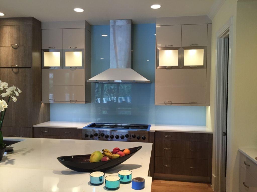 Blue Back Painted Glass Backsplash In Modern Kitchen