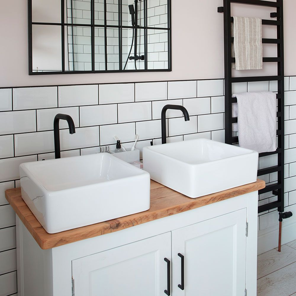 Photo of Bathroom makeover with freestanding bath walk in shower and his and her sinks