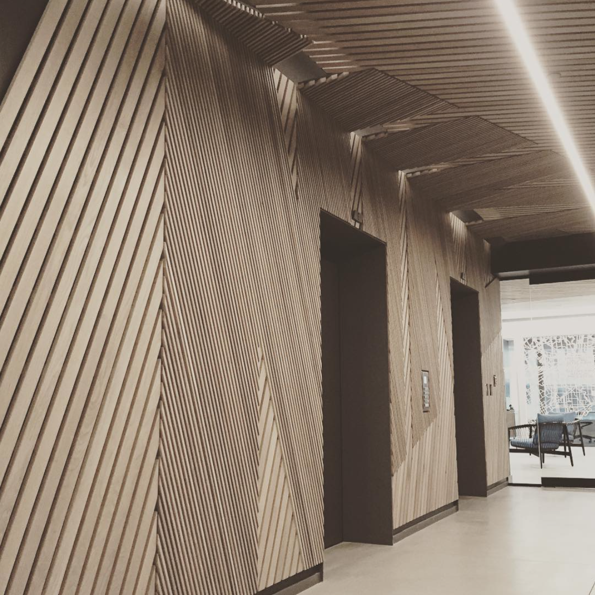 Elevator lobby: thin wooden slats placed at opposing ...