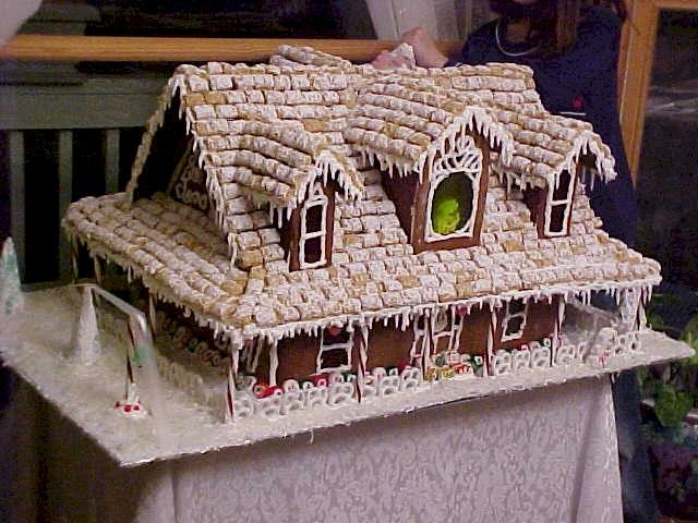 WOW!  I cannot even imagine how much gingerbread was needed for this house by Leon Cretel!  Not to mention how many boxes of shredded mini-wheats were needed for the roof!  A very stunning gingerbread house!