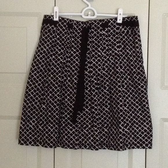 Loft black and white skirt Loft black and white skirt with black ribbon to tie or let hang. Note--this item is listed twice in my closet LOFT Skirts