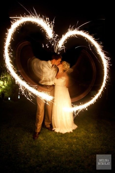 """I would totally do this if I could get over my fear of being burnt by sparklers- Not sure why they scare me so much but this has to be one of the cutest """"just married"""" pictures I have seen. Love"""