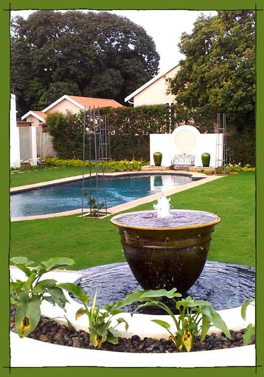 Circular water feature and reflective pool in a Formal Garden in