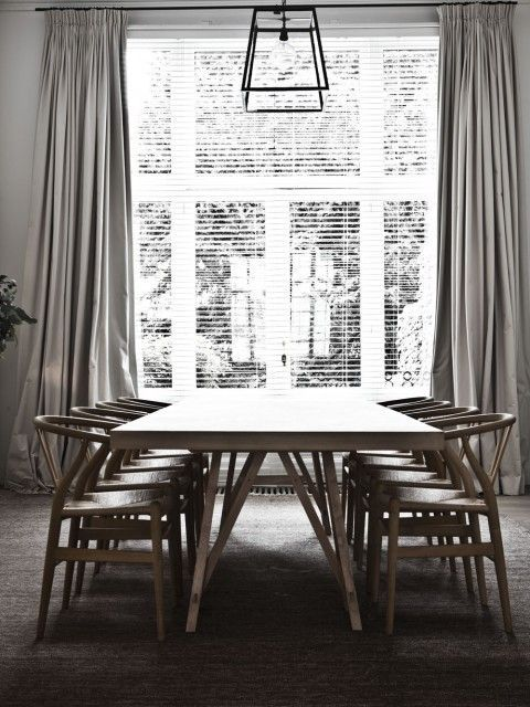 Floor To Ceiling Windows In A Lofty Dining Room With Horizontal Blinds And A