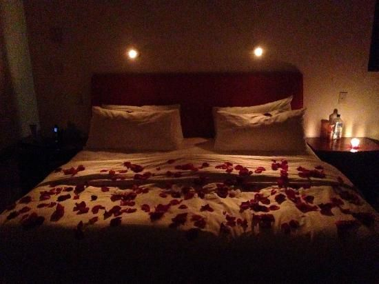 Rose Petals On Bed With Candles