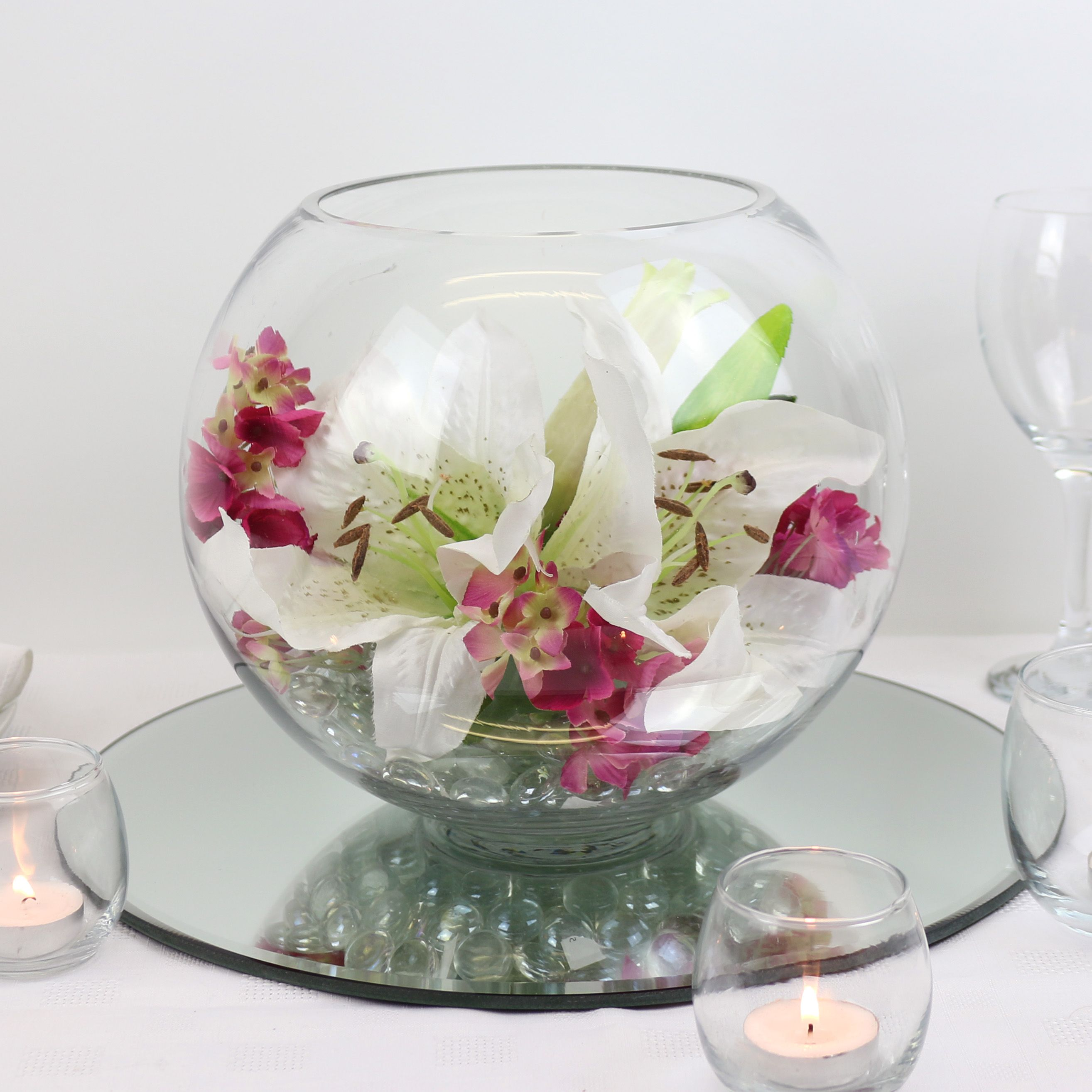 Fishbowl centrepiece with giant lily heads. | Wedding planning ...