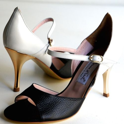 www.felinashoes.com Argentine Tango Shoes from Comme il Faut shoes. Open toe, single ankle strap, enclosed pointed heel cage. Black and white leather, gold stiletto heels, gold leather sole. Sizes 4 (34), Size 5 (35), Size 6 (36), Size 7 (37), Size 8 (38), Size 9 (39), Size 10 (40), Size 11 (41)
