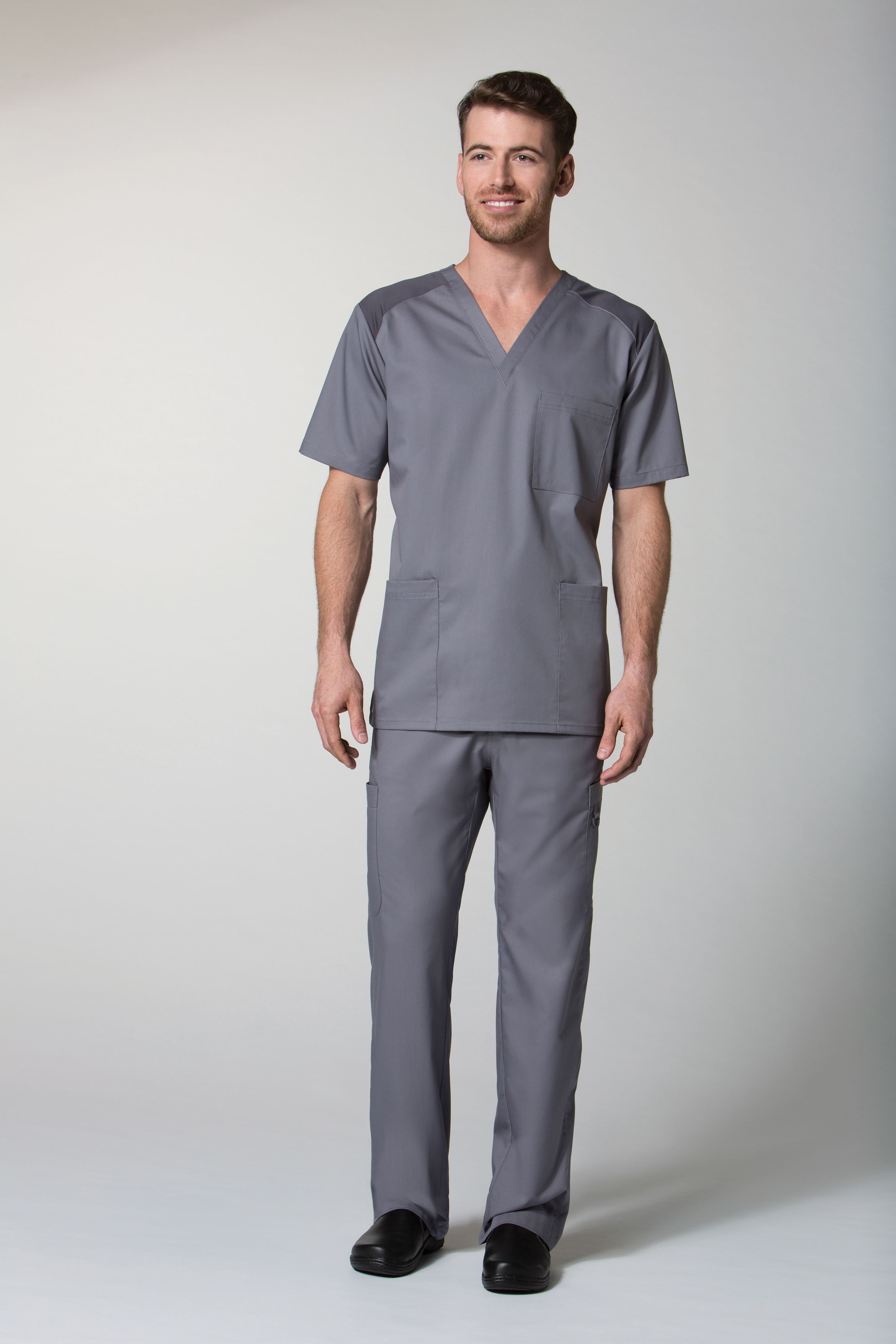 c4c10f48fb4 Our EON mens scrub top has all the necessities for any guy in the medical  industry
