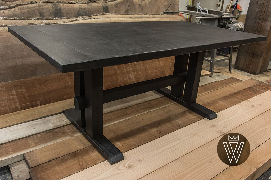 Worth Doing Well unique furniture design - Custom scorched finish dining table with reclaimed timber legs.