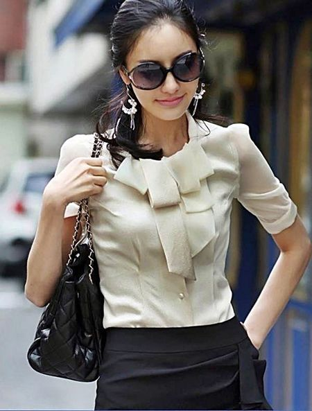 Elegant white shirt in eye-catching design. http://www ...