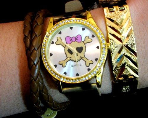 Lady skull head watch, gold bracelet, and brown leather wrap set.