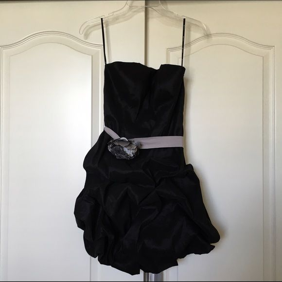 Forever 21 Black Strapless Ruffle Homecoming Dress Forever 21 black strapless ruffle short dress. It has been worn ONCE for my sister's promotion ceremony. The dress is in perfect condition except for the little string that came detached on the left side. The string on the right side is still attached. It's really not a problem because the flower belt is self-tie so it stays on even without the strings in place. Comes from a smoke-free and pet-free home.  • Size: medium  Price is negotiable…