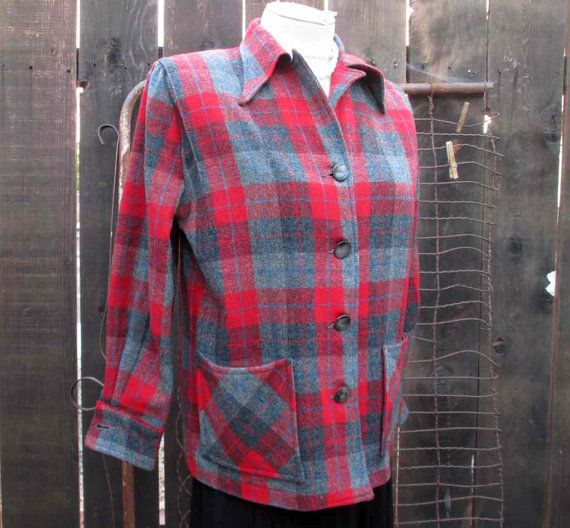 Vintage 1950s Plaid 49er is an unlined wool ladies shirt jacket in red, gray, and a dark gray plaid. In the classic style of a Pendleton 49er,