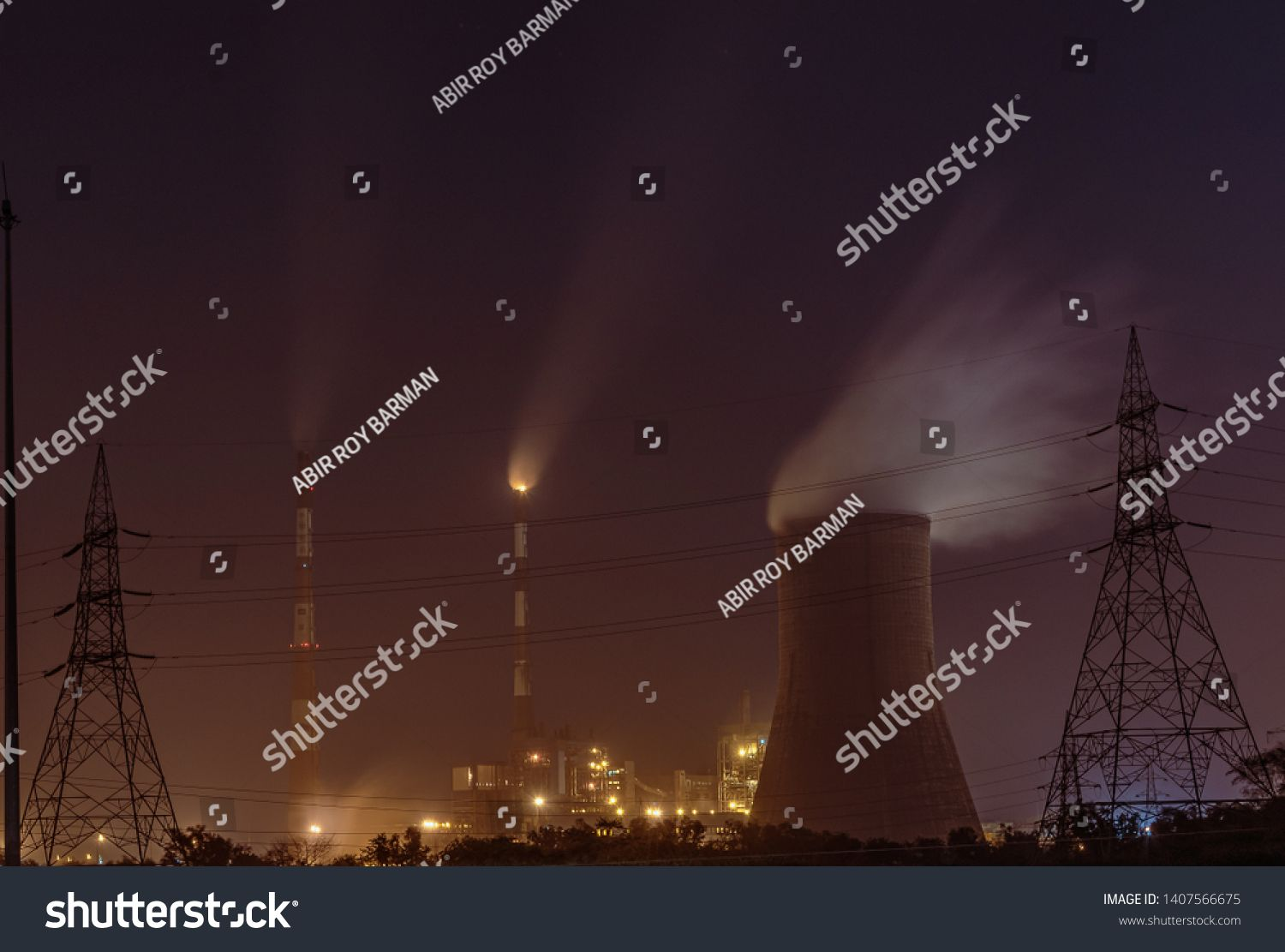 Photo Of Power Plant With Cooling Tower And Chimney At Night