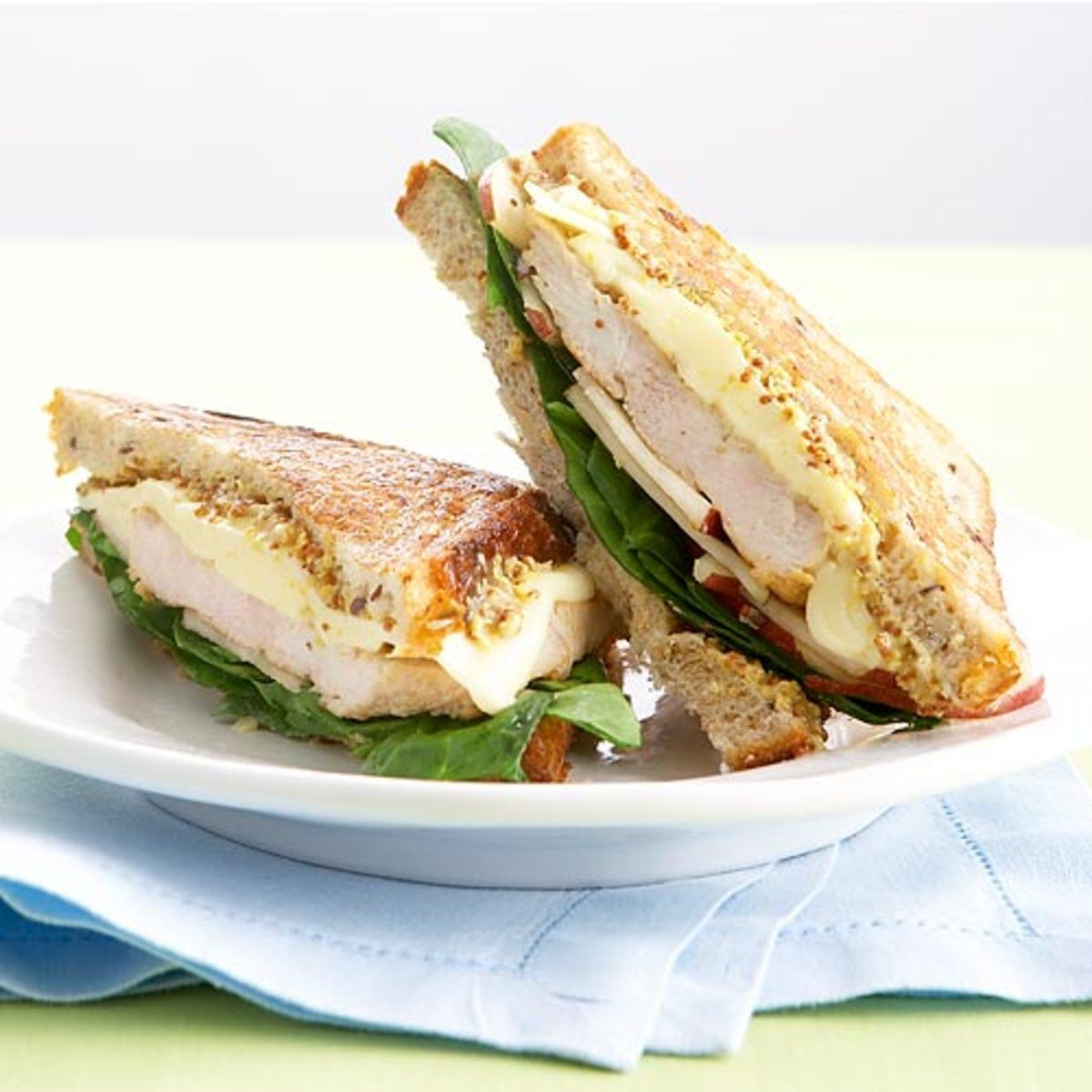 A Better Monte Cristo Sandwich #montecristosandwich Ditch the traditional butter-fried Monte Cristo for a healthier, tastier take. Sautéed turkey, pear, baby spinach and low-fat Swiss spare the fat but not the flavor. #montecristosandwich