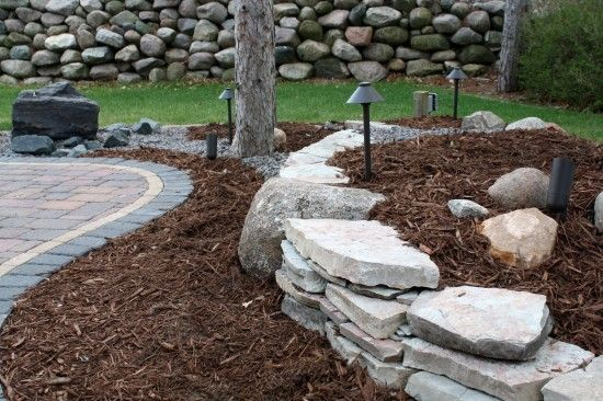 Landscape Berms With Rocks | Re-purposed flagstone into small