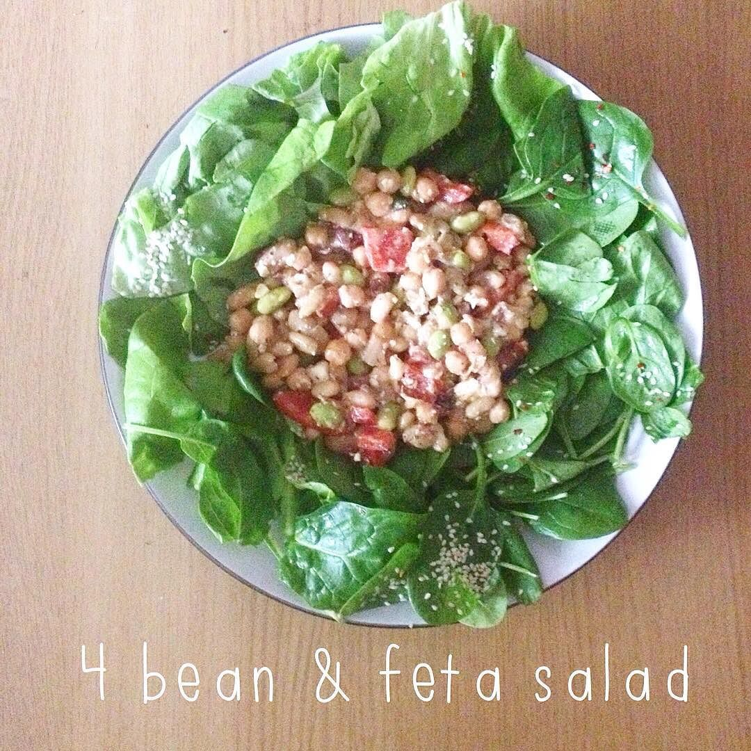 One of my fave 5 minute meals  a bed of spinach lettuce & sesame seeds topped with a mix of edamame cannellini flageolet & adzuki beans chickpeas red peppers feta garlic olive oil & chilli. So quick to make and totally delicious