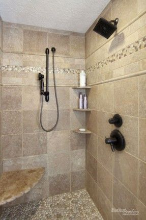 Travertine tile shower with \'Java Tan\' pebble tile floor and glass ...