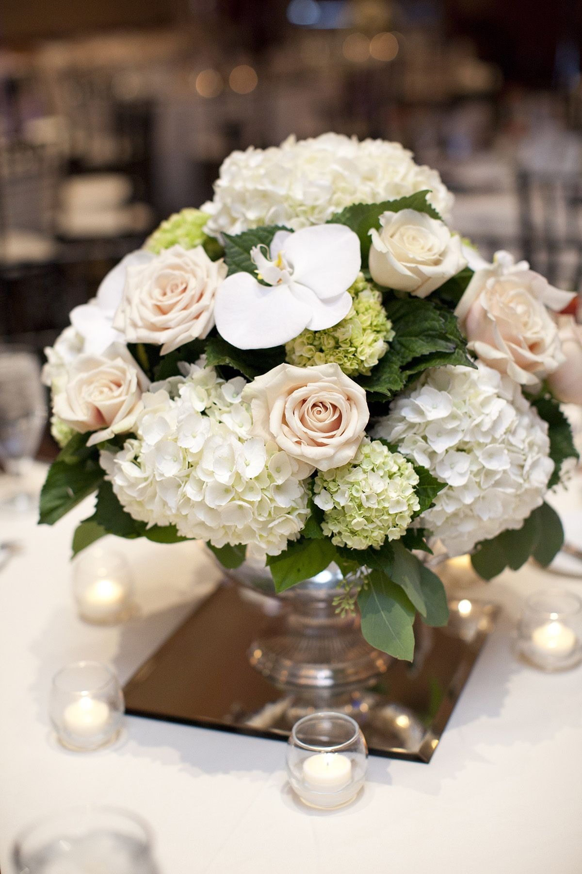 Low Centerpiece With Champagne Roses Green And White Hydrangeas And