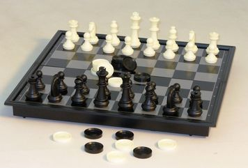 """12"""" Magnetic Chess with Checkers is a Folding Magnetic Metal Board, great for travel or outdoors! It has a 2.5"""" high King with plastic magnetic chessmen, and includes plastic checkers (non-magnetic) that are 7/8"""" diameter. Board has 1.3"""" square."""