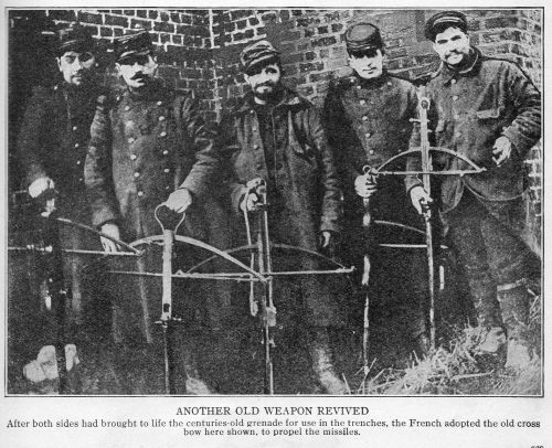 """WW1. """"Another Old Weapon Revived. After both sides had brought to life the centuries-old-grenade for use in the trenches, the French adopted the old cross bow here shown, to propel the missiles."""""""