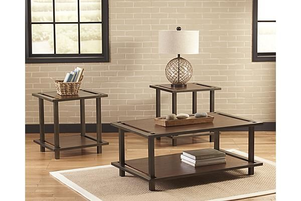"The Shanklin Table (Set of 3) from Ashley Furniture HomeStore (AFHS.com). The ""Shanklin"" accent table collection features the unique contemporary design of the welded tubular metal base covered in a bronze color powder coat finish supporting the medium brown finished table top and shelf to flawlessly capture a sleek collection that is sure to enhance the décor of any living room."