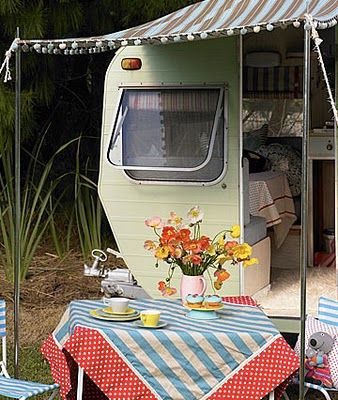 camping and picnicking with a little old caravan