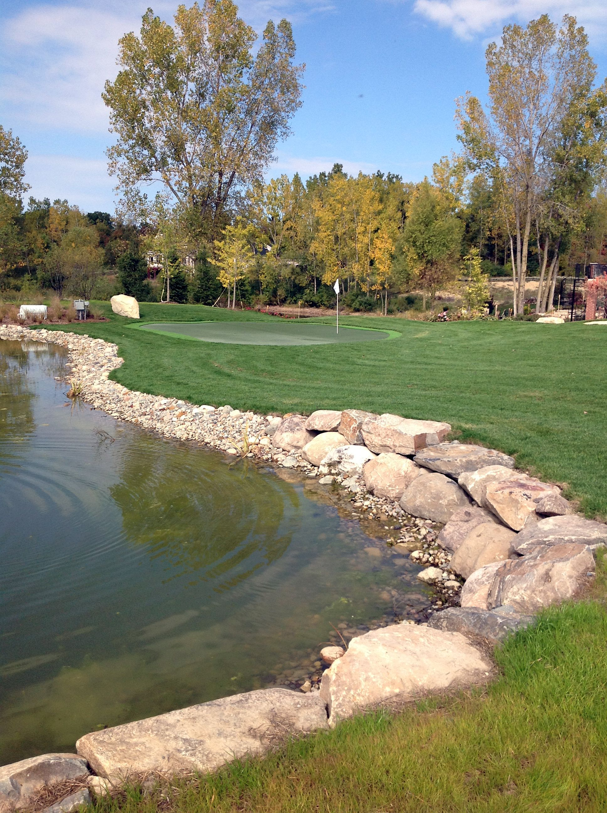 Field Boulder Retaining Wall Separating The Private Home Golf Course From The Man Made Pond Lake Landscaping Pond Landscaping Farm Pond