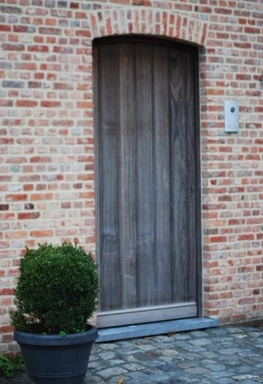 A wooden rural door in its purest form. Robust and …