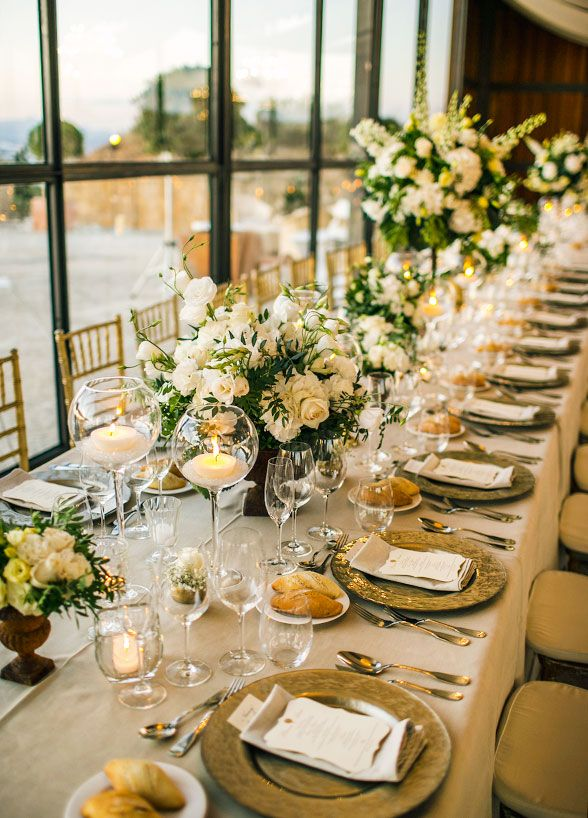 Elegant banquet tables were covered with green and white floral arrangements in varying heights all accented by classic gold. Wedding Decorations, White Wedding