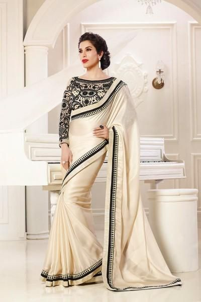 4b8552c4b8ac47 Off-white shimmer georgette saree with contrast embroidered net blouse in  black with stone studded georgette sleeves. Comes with embroidered and gold  lace ...