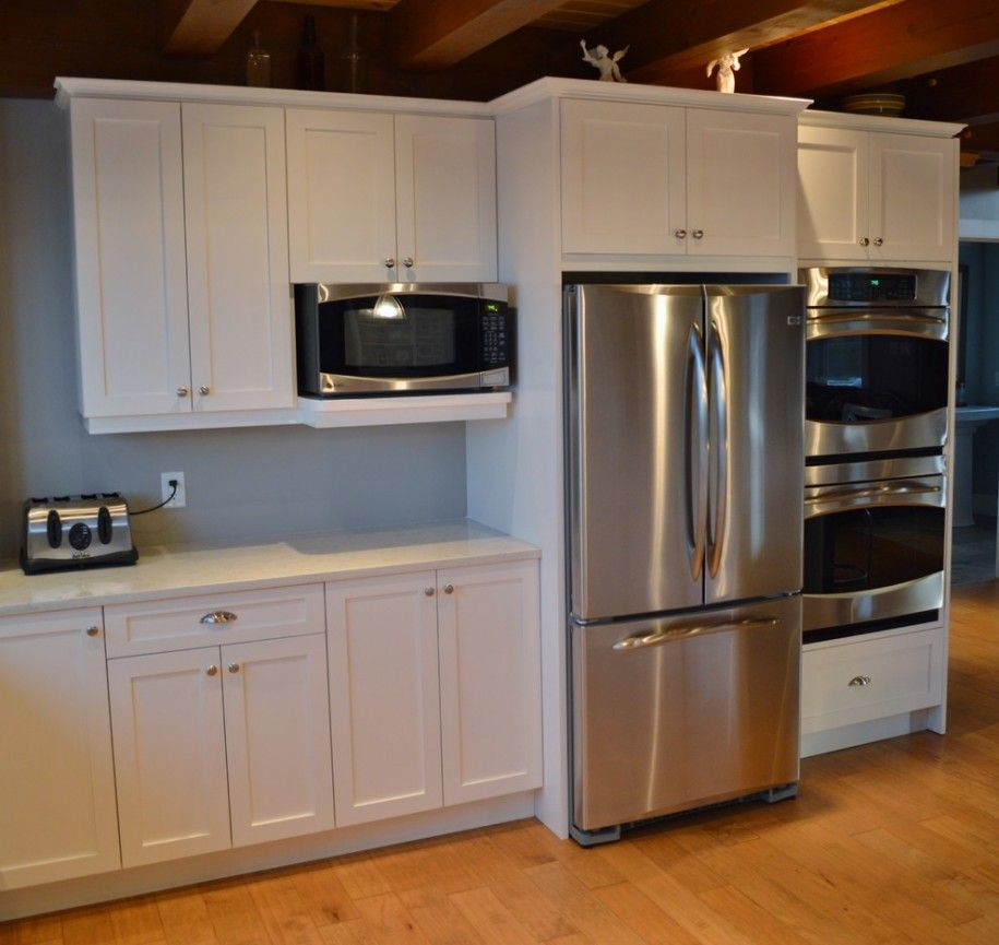 Here is a side by side in which the fridge sticks out for Built in oven kitchen cabinets