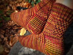 Ravelry: Crossed Wires pattern by Nathan Taylor.  Simple gusset detail wins every time.