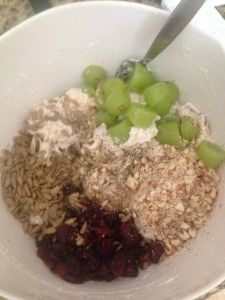 Healthy Chicken Salad 3 medium chicken breasts 1 tablespoon chicken bouillon powder or 2 cubes 3/4 cup PLAIN (not vanilla…trust me) nonfat greek yogurt 1/2 cup dried cranberries 1/2 cup sliced grapes 1/2 cup dry roasted sunflower seeds 1/2 cup coarsely chopped pecans or almonds 1/2 teaspoon onion salt 1/2 teaspoon pepper