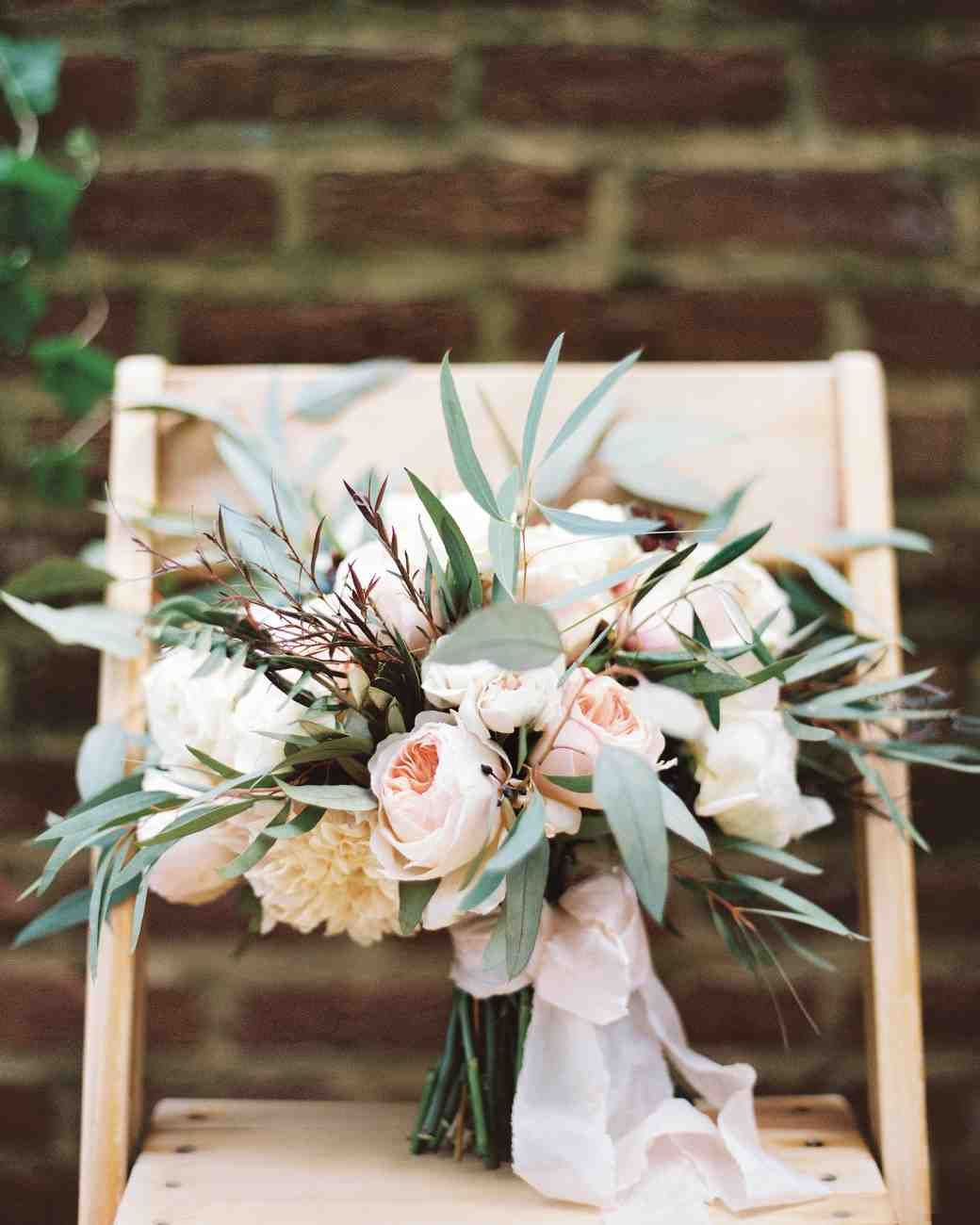roses and dahlias with leafy eucalyptus, olive branches, and burgundy agonis - 25 Gorgeous Fall Wedding Bouquets | Martha Stewart Weddings
