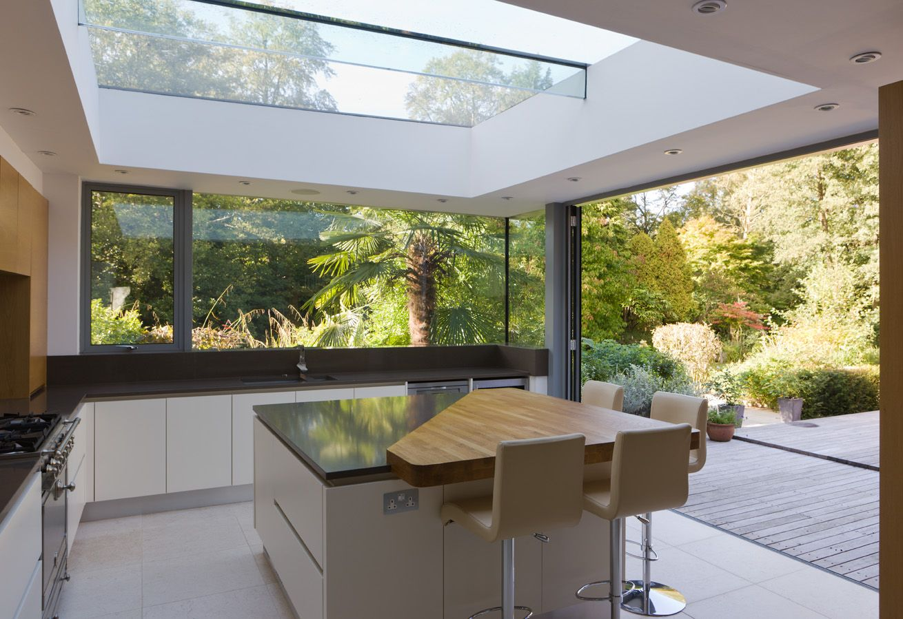 A Modern Kitchen Extension With Structurally Glazed Wrap