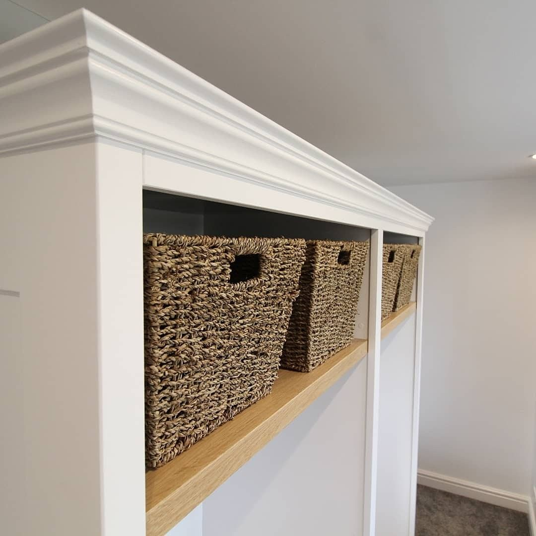 Bespoke Under Stairs Shelving: Wicker Basket Storage In This Handmade Wardrobe. Part Of A