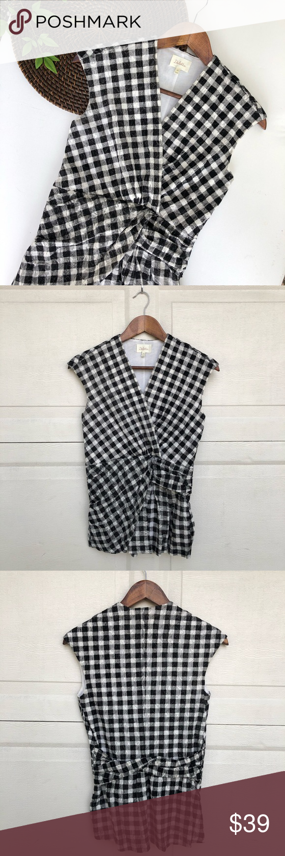 Anthro Deletta l Black White Gingham Blouse XS Anthro Deletta Womens Black White Gingham Plaid Blouse Sleeveless XS  Very Good Pre Owned Condition  No holes stains or missing buttons   Measurements Approximate Laying Flat  Chest 15 in Length 25.5 in  Fa-1119-0630  Doxp Anthropologie Tops Blouses
