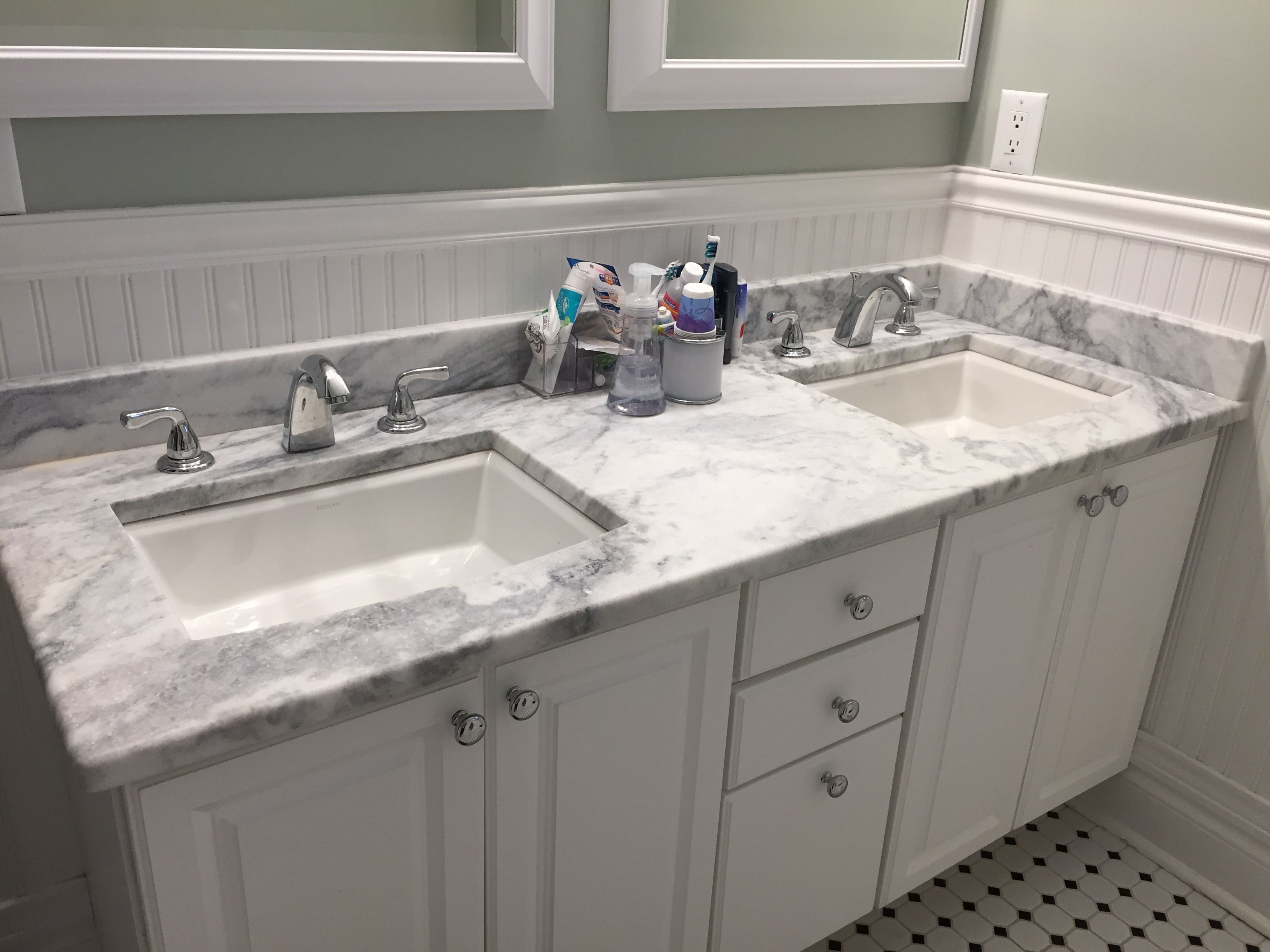 mont blanc honed quartzite vanity countertop in a traditional hall bathroom with beadboard bathroom vanity