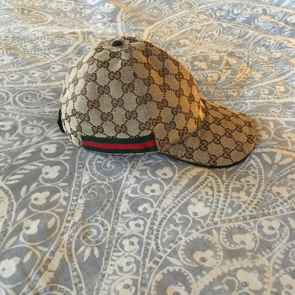 793b39b2e3dd8 Gucci baseball cap Authentic original logo Gucci hat. Worn a handful of  times. Adjustable Velcro back closure. All over canvas with brown leather  trim.