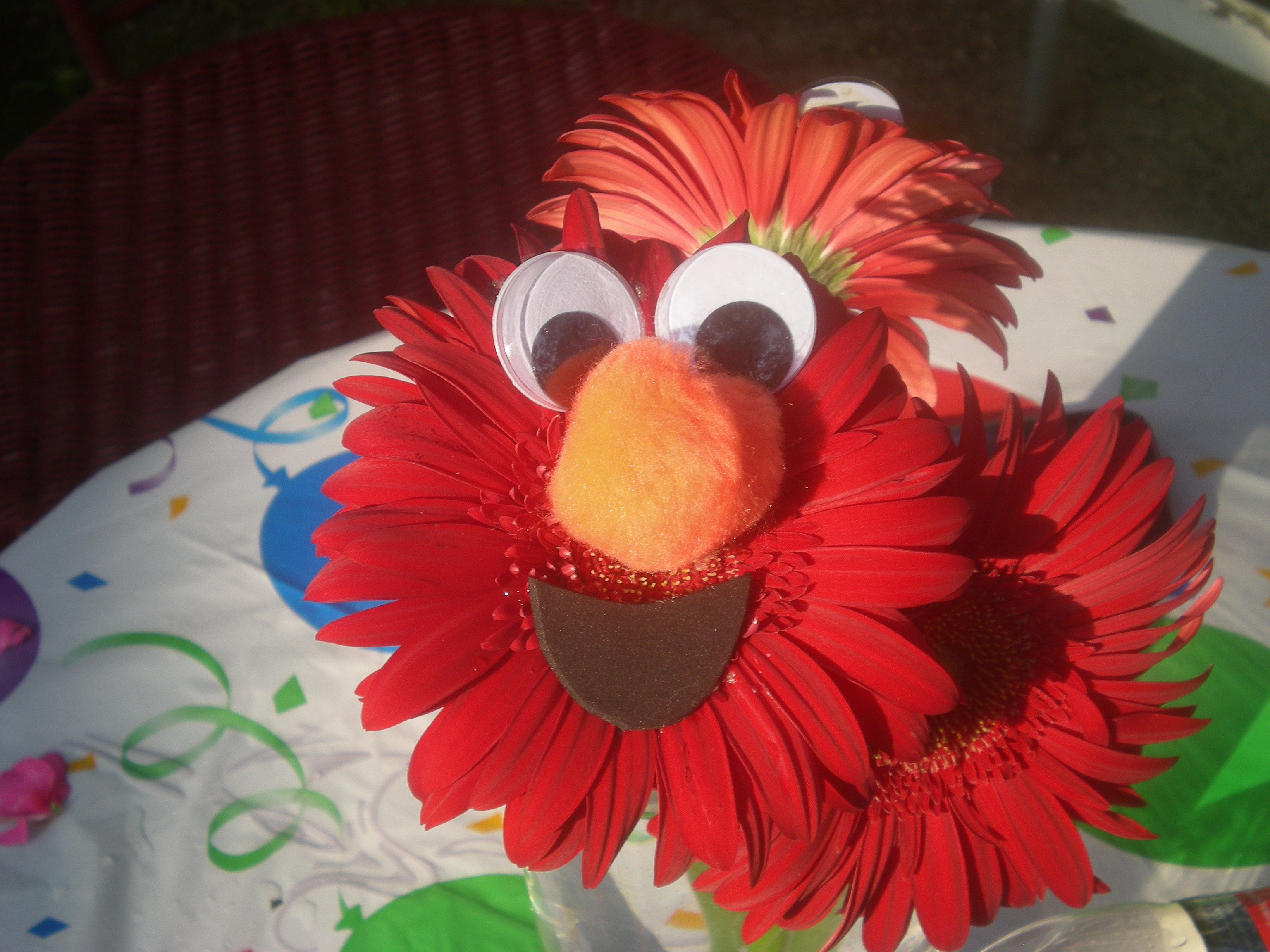 Elmo flower centerpieces for kids birthday partiesd gerber elmo flower centerpieces for kids birthday partiesd gerber daisies flower glue dhlflorist Image collections