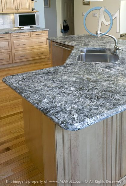 The beautiful Azul Aran granite creates an ultra-modern ...