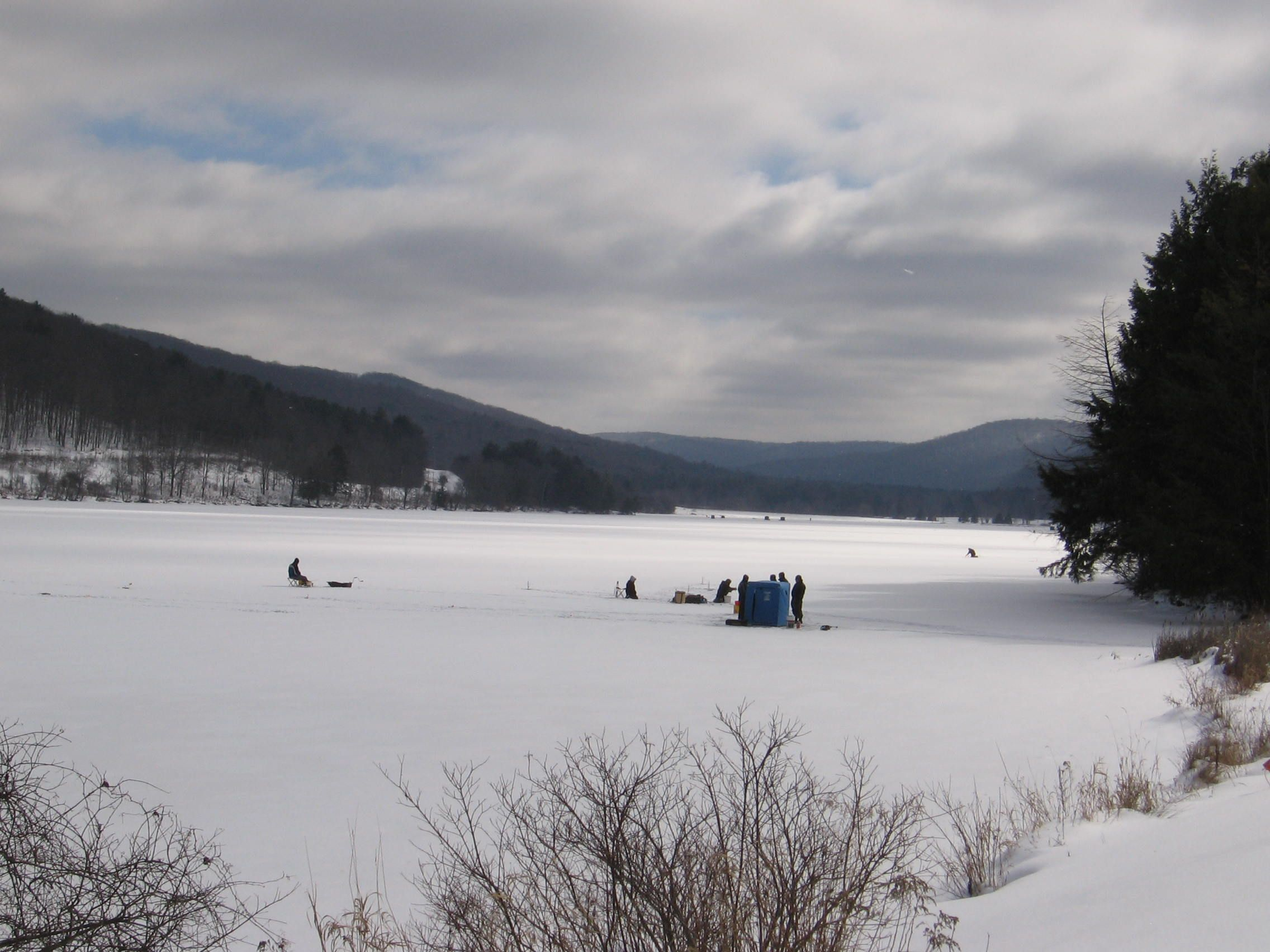 Ice Fishing Can Be Exciting And Fun Cattaraugus County Has Allegany State Park That Attracts Numerous Winter Time Allegany State Park State Parks Small Lake
