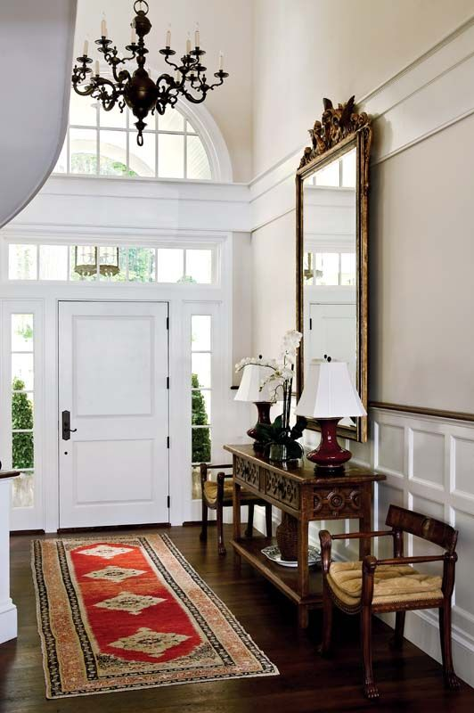 Large Foyer Decorating Ideas the high-ceiling foyer is outfitted with antiques collected over