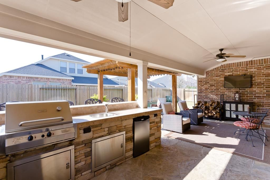28511 Spiceberry Dr Katy Tx 77494 Photo This Outdoor Kitchen Has It All Built In Smoker Gas Grill Sink And Fridge For Barbecue Area Home Decor Outdoor Spaces