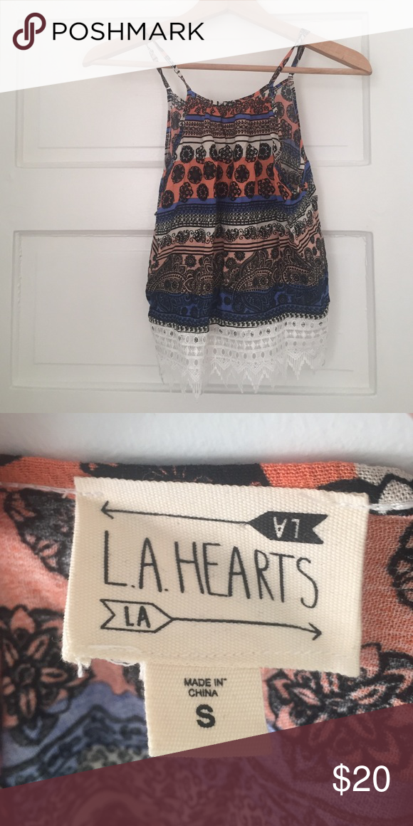 Multicolor LA Hearts tank top Multicolored sleeveless tank top with a high neckline. Kind of short so would work well as a crop top as well. Size small, great condition and barely worn. Price negotiable! LA Hearts Tops Tank Tops