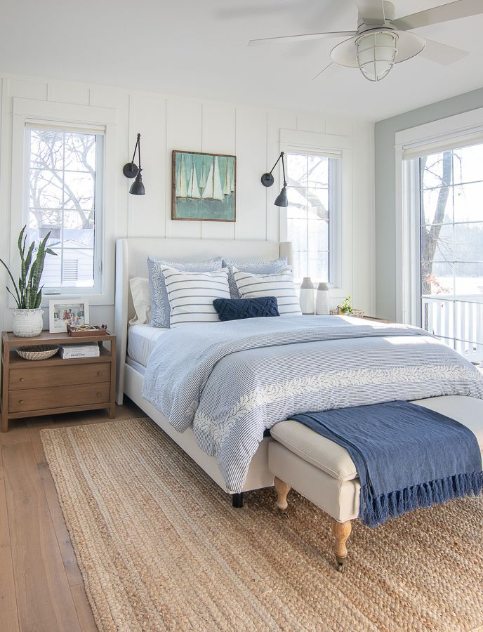 White And Blue Lake House Master Bedroom The Lilypad Cottage In 2020 White Upholstered Bed Home Bedroom Bedroom Interior