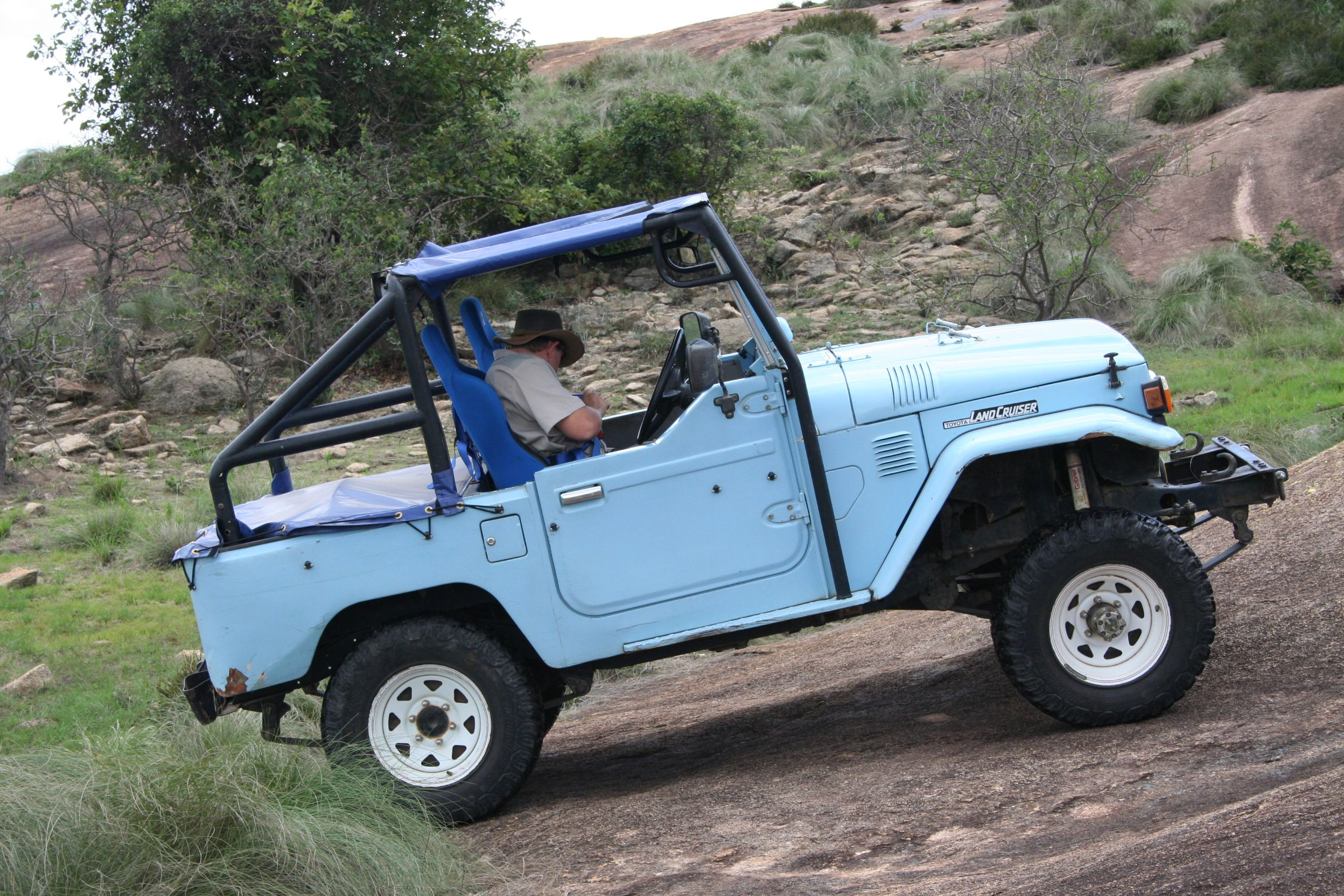 Wheeling A Piece Of Granite Rock In Zimbabwe Fj40 Toyota Fj40 Fj40 Land Cruiser