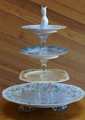 "Vintage tiered server. Orphan antique dishes + crystal candlesticks + cute ""pie bird"" embellishment on top = Voila!"